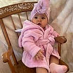 Eyes, Baby & Toddler Clothing, Human Body, Purple, Comfort, Sleeve, Pink, Headgear, Baby, Violet, Toddler, Magenta, Linens, Thigh, Cap, Baby Products, Thumb, Chair, Sock, Lap, Person, Headwear